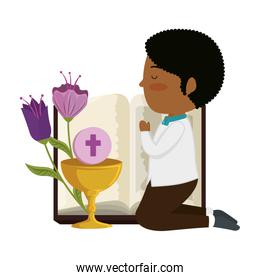 little black boy kneeling with book and chalice first communion