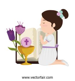 little kneeling girl with bible and flowers first communion