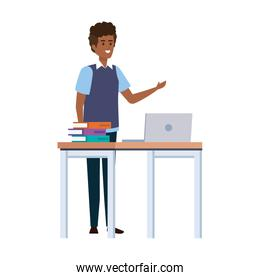 young black teacher in desk with laptop and books