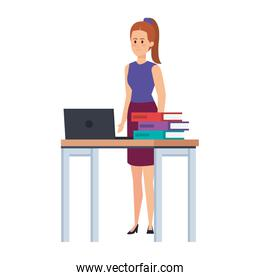 young teacher female in desk with laptop and books