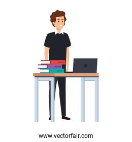 young teacher in desk with laptop and books