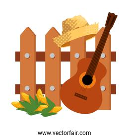 wooden fence with guitar and gardener straw hat