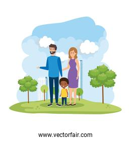 interracial parents couple with son in the park scene