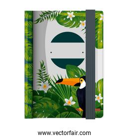 text book with tropical fauna print