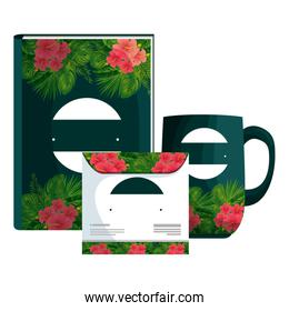 text book and mug ,cd with tropical flowers print