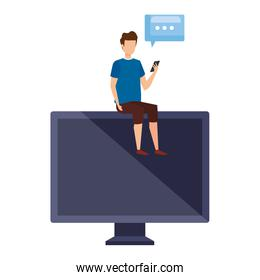 young man using cellphone seated in computer with speech bubble