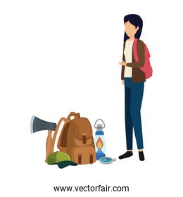 young woman with camping travel bag and equipment