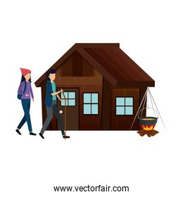 couple with log cabin with wood fire