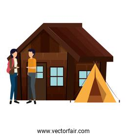 couple with log cabin with tent