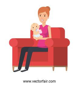 mother lifting little baby seated in sofa