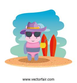 cute female hippo with summer hat and pineapple cocktail on the beach