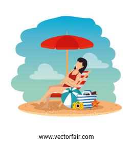 beautiful woman with swimsuit seated in beach chair and bag on the beach