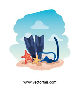 diving snorkel mask and fins with starfish on the beach
