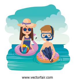 little kids couple with snorkel and balloon on the sea