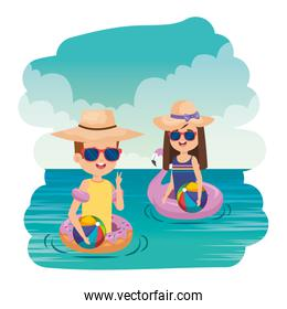 little kids couple with floats and balloons in the sea