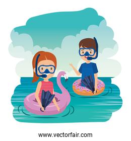 little kids couple with floats and snorkels in the sea