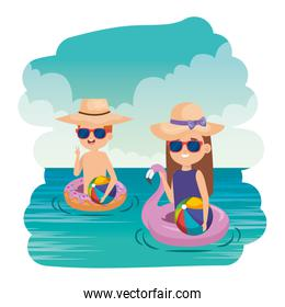 little kids couple with floats and balloons in the sea scene