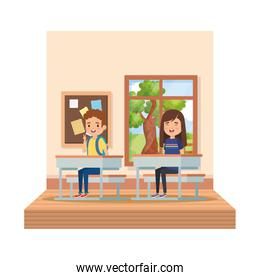 little students couple in school desk on the classroom