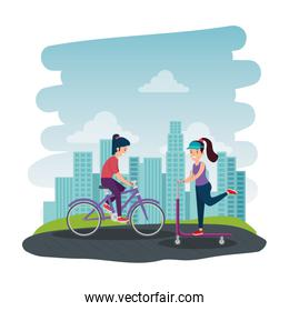 athletic girls in skateboard and bicycle on the park