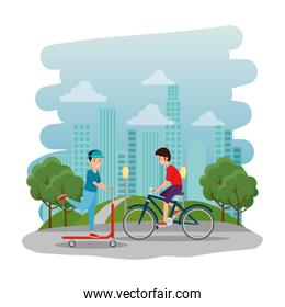 athletic boys ride bike and skateboard on the park