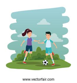 smiling athletic couple practicing football soccer on the park