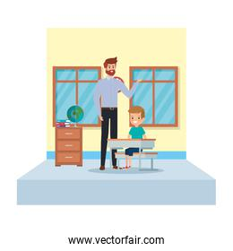 male teacher and boy seated in desk in the classroom