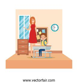 female teacher and boy seated in desk in the classroom