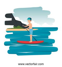 happy athletic boy practicing surf in the sea