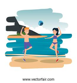 happy athletic couple practicing volleyball on the beach