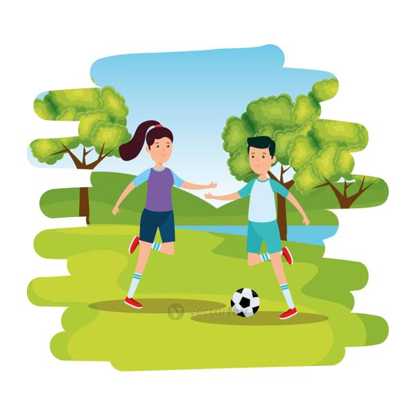 happy athletic couple practicing football soccer on the park