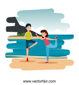 athletic couple practicing exercice on the beach