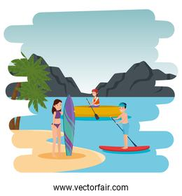 couple practicing surf sport and kayak on the beach