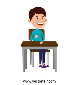 happy student boy seated in school desk
