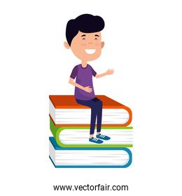 happy student boy seated in pile books