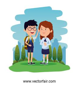 happy little students couple with schoolbag in the field