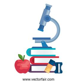 pile textbooks with microscope and supplies