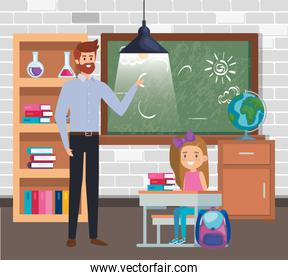 male teacher with student girl in the classroom
