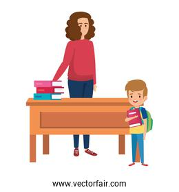 happy student boy with female teacher in desk