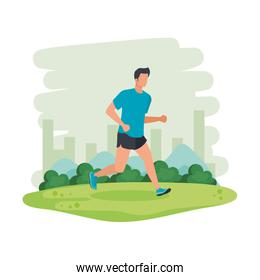 young athletic man running in the landscape
