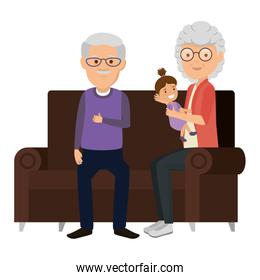 grandparents couple with granddaughter in the sofa