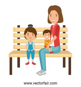 mother with kids in park chair