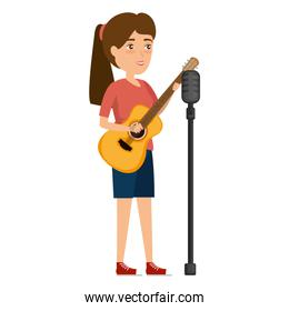 woman singing with microphone and playing guitar
