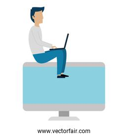 young man working with laptop and monitor