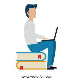 young man working with laptop in books