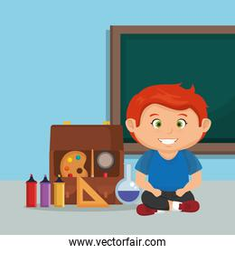 little schoolboy with education supplies