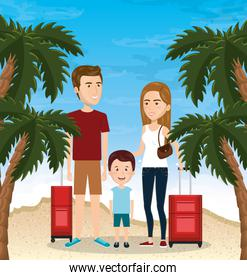 parents with son on the beach