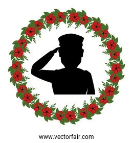 silhouette of soldier saluting with wreath flowers