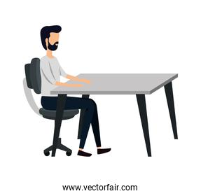 elegant young businessman in office chair and table