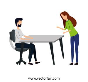 elegant young business couple seated in table