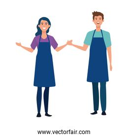 happy young artist couple with aprons